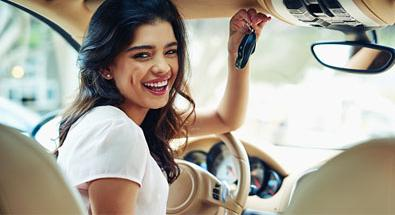 Woman laughing in a car